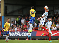 Taylor Moore (Bristol City) of England heads clear during the International match between England U20 and Brazil U20 at the Aggborough Stadium, Kidderminster, England on 4 September 2016. Photo by Andy Rowland / PRiME Media Images.