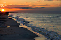 The sun rises over Dauphin Island, Alabama, a barrier island located three miles south of the mouth of Mobile Bay in the Gulf of Mexico. This island, which is approximately 14 miles long and less than two miles wide, appears to have fully recovered from the impact of Hurricane Katrina (2005) and the BP Deepwater Horizon Oil Spill in 2010. Both events greatly reduced tourism income (fewer people came to the island) and local business owners say many establishments went out of business. Today they say they're looking forward to a rebounding tourism business.