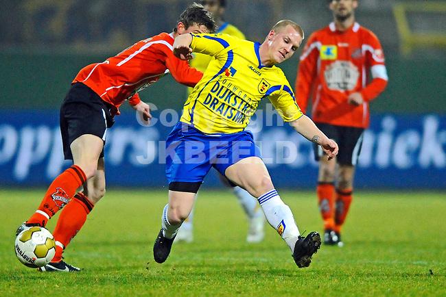 LEEUWARDEN - Voetbal, SC Cambuur - FC Volendam, Cambuur stadion, seizoen 2011-2012, 02-03-2012 Cambuur speler Martijn van der Laan wordt uit evenwicht gebracht door Volendammer.