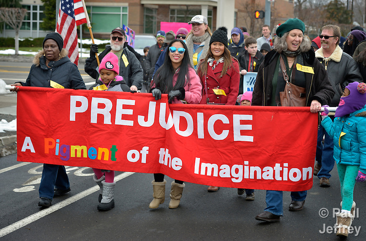 Participants carry a banner against prejudice in a January 18, 2016, march commemorating Martin Luther King, Jr. Day in Yakima, Washington.