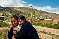 Young Colombian girls on the way home from school in Ciudad Bolívar, Bogota, Colombia, 25 August 2008. The area of Ciudad Bolívar, a shanty town in the southwestern part of Bogota, concentrates the poorest population of Colombia's capital city. A lot of its inhabitants are war fugitives violently displaced from their original rural lands by guerrilla or paramilitary forces, both involved in the Colombian armed conflict.