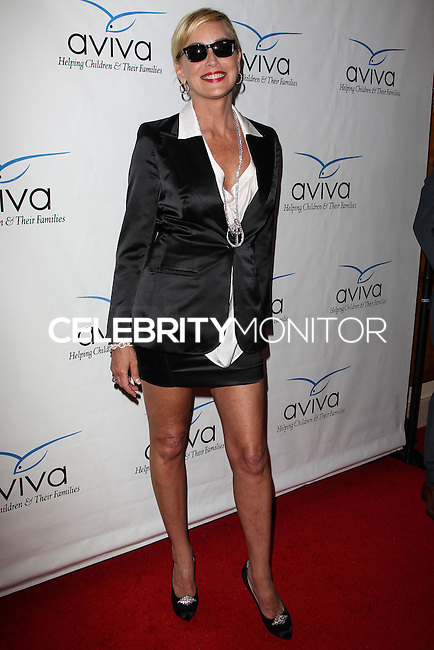 """BEVERLY HILLS, CA, USA - MAY 31: Actress Sharon Stone arrives at the Aviva Family And Children's Services Annual """"A"""" Fundraising Gala held at the Regent Beverly Wilshire Hotel on May 31, 2014 in Beverly Hills, California, United States. (Photo by Celebrity Monitor)"""