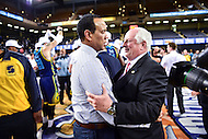 MAR 7, 2016: Baltimore, MD - North Carolina-Wilmington Seahawks head coach Kevin Keatts and Commissioner Tom Yeager share a moment following North Carolina-Wilmington Seahawks winning the CAA Basketball Tournament at Royal Farms Arena in Baltimore, Maryland. (Photo by Philip Peters/Media Images International)