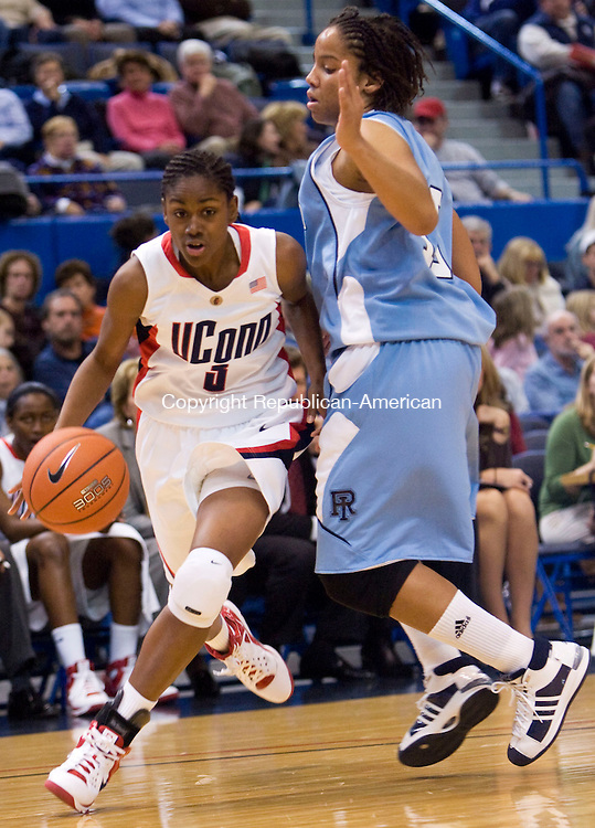 HARTFORD, CT - 22 NOVEMBER 2008 -112208JT10-<br /> UConn's Tiffany Hayes dribbles past Rhode Island's Lindsay Harris during Saturday's game at the XL Center in Hartford. The Huskies won, 91-43.<br /> Josalee Thrift / Republican-American