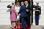 U.S. President Donald Trump, from right, Benjamin Netanyahu, Israel's prime minister, Melania Trump and Sara Netanyahu greet one another as they arrive at the South Portico of the White House in Washington, D.C., U.S., on Wednesday, Feb. 15, 2017. Netanyahu is trying to recalibrate ties with Israel's top ally after eight years of high-profile clashes with former President Barack Obama, in part over Israel's policies toward the Palestinians. <br /> Credit: Andrew Harrer / Pool via CNP