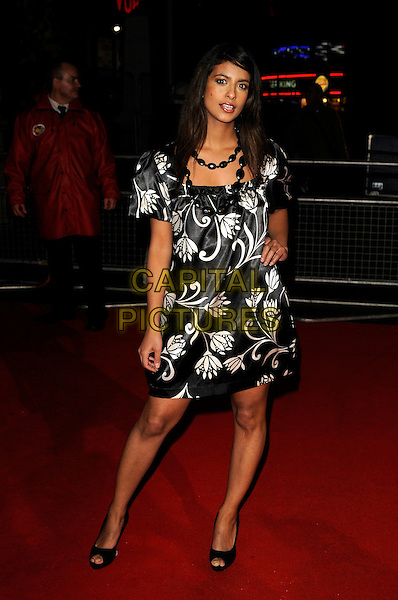 "KONNIE HUQ.""Sweeney Todd: The Demon Barber of Fleet Street"" European film premiere, Odeon cinema, Leicester Square, London, England..January 10th, 2008 .full length black white dress silk satin pattern necklace hand on hip.CAP/CAN.©Can Nguyen/Capital Pictures"