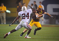 Sept 6, 2008; Tempe, AZ, USA; Arizona State University Sun Devils wide receiver (13) Chris McGaha is pursued by Stanford Cardinal cornerback Chris Evans at Sun Devil Stadium. Mandatory Credit: Mark J. Rebilas-