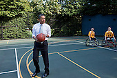 Washington, DC - October 8, 2009 -- United States President Barack Obama prepares to take a shot during a game played by members of the National Naval Medical Center Marine Wounded Warrior basketball team on the White House basketball court, October 8, 2009.    .Mandatory Credit: Pete Souza - White House via CNP