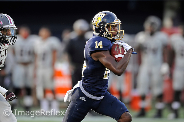 19 September 2015:  FIU wide receiver/kick return specialist Dennis Turner (14) takes a reception 64 yards for a touchdown in the first quarter as the FIU Golden Panthers defeated the North Carolina Central University Eagles, 39-14, at FIU Stadium in Miami, Florida.