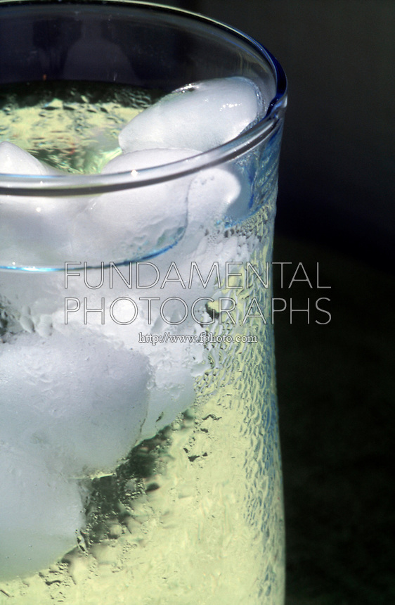 ICE MELTING IN A GLASS WITH CONDENSATION<br /> Condensation on  Glass of  Ice Water<br /> A substance condenses when the pressure exerted by its vapour exceeds the vapour pressure of the liquid or solid phase of the substance at the temperature of the surface where condensation occurs.