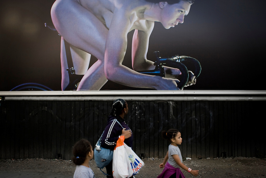 Cyclist Rebecca Romero towers over local residents in an advertisement for Powerade on Shoreditch High Street. The campaign featured British Olympians photographed taking part in their respective sports events naked. Cathryn Sleight, marketing director for Coca-Cola Great Britain added: 'We wanted to give people the chance to see the real make-up of an athlete and their muscle and power, celebrating the body and spirit.' Source: www.coca-cola.co.uk
