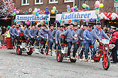 Düsseldorf, Germany. 27 February 2017. Ammerländer Radfahrer, cyclists from Ammerland, on a huge bicycle. Carnival parade on Shrove Monday (Rosenmontag) in Düsseldorf, North Rhine-Westphalia, Germany.