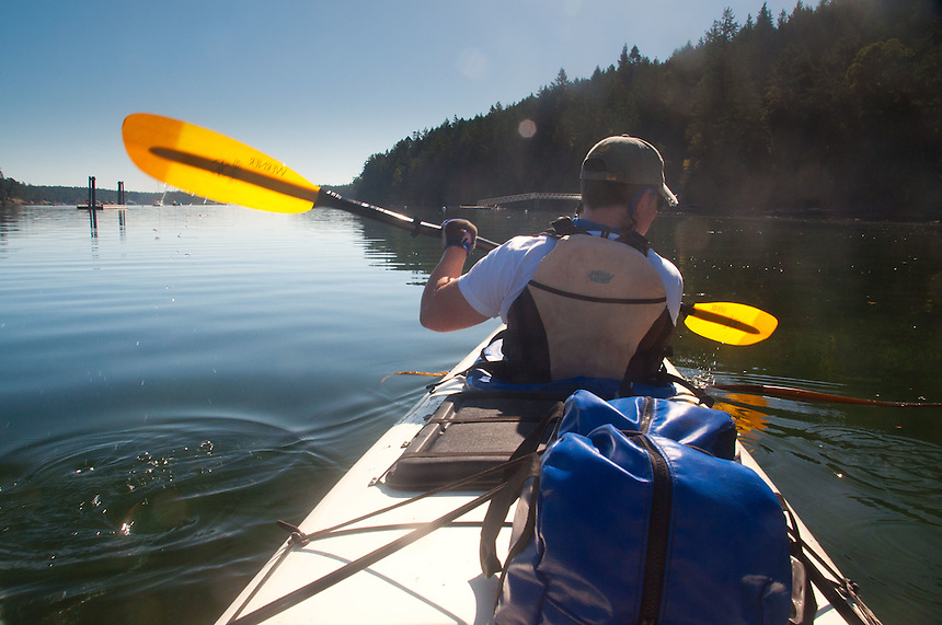 Taylor Paddles Out of Reid Harbor, Stuart Island, Washington, US