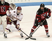 Erin Connolly (BC - 15), Paige Capistran (NU - 12) - The Boston College Eagles defeated the Northeastern University Huskies 2-1 to win the Beanpot on Monday, February 7, 2017, at Matthews Arena in Boston, Massachusetts.