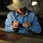 A Cuban tobacco farmer preparing to smoke his hand rolled cigar