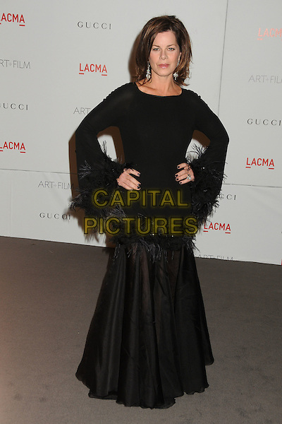 Marcia Gay Harden.The Inaugural Art and Film Gala held at LACMA in Los Angeles, California, USA..November 5th, 2011.full length black dress feathers hand on hip.CAP/ADM/BP.©Byron Purvis/AdMedia/Capital Pictures.