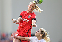 Portland, Oregon - Sunday October 2, 2016: Portland Thorns FC midfielder Amandine Henry (28) heads the ball away from Western New York Flash midfielder McCall Zerboni (7) during a semi final match of the National Women's Soccer League (NWSL) at Providence Park.