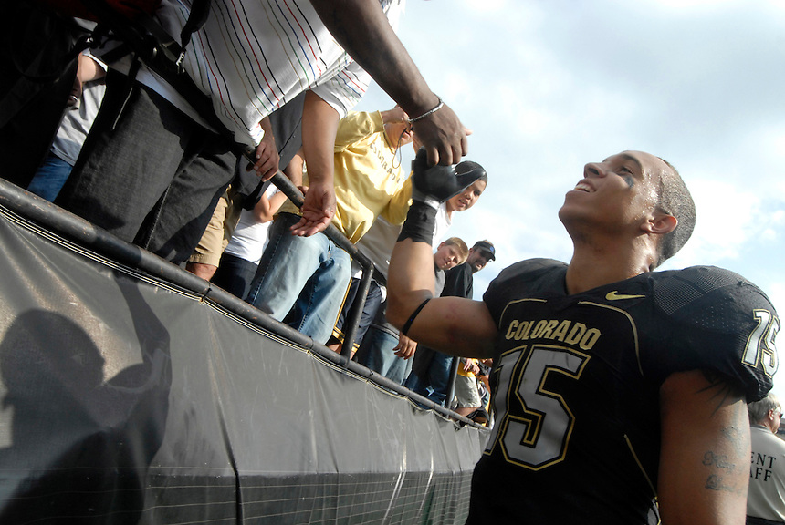 06 September 08: Colorado safety Ryan Walters slaps hands with fans after a game against Eastern Washington. The Colorado Buffaloes defeated the Eastern Washington Eagles 31-24 at Folsom Field in Boulder, Colorado. FOR EDITORIAL USE ONLY