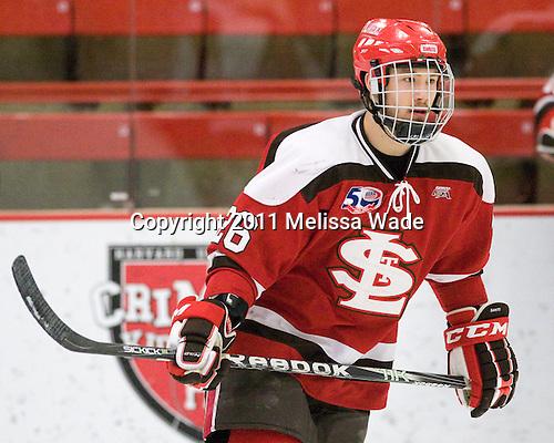 Kyle Essery (St. Lawrence - 26) - The Harvard University Crimson defeated the St. Lawrence University Saints 4-3 on senior night Saturday, February 26, 2011, at Bright Hockey Center in Cambridge, Massachusetts.