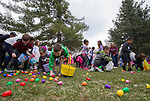 Children race to pick up Easter eggs during the Community Easter Egg Dash at Idlewild Park in Reno, Nevada on Saturday, March 31, 2018.
