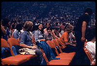Yes performing at the New Haven Coliseum on 9 August 1977. Fans waiting for lights to go down. Note the blue haze house lights the Coliseum was famous for back in the 70's.