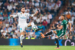Sergio Ramos of Real Madrid (L) fights for the ball with Victor Camarasa Ferrando of Real Betis (R) during the La Liga 2017-18 match between Real Madrid and Real Betis at Estadio Santiago Bernabeu on 20 September 2017 in Madrid, Spain. Photo by Diego Gonzalez / Power Sport Images