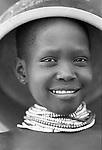 Turkana girl and cooking pot in a traditional village nr Kakuma, Northern Kenya.