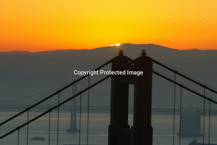 The sunrise peeked over the east bay hills lighting up both the Bay and Golden Gate Bridge in the Bay Area.