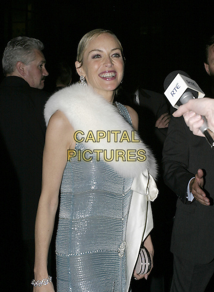 SHARON STONE.Catwoman After Party At Sketch Club In Mayfair, London.August 3rd, 2004.half  length, blue metallic dress, white fur, signing autographs.www.capitalpictures.com.sales@capitalpictures.com.© Capital Pictures.