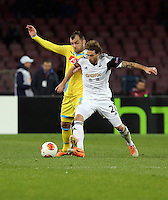 Thursday 27 February 2014<br /> Pictured: Jose Canas of Swansea (R) challenged by a Napoli player<br /> Re: UEFA Europa League, SSC Napoli v Swansea City FC at Stadio San Paolo, Naples, Italy.