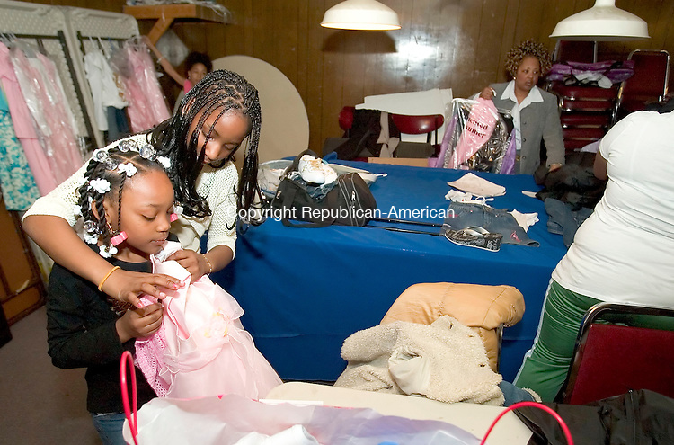 WATERBURY, CT--08 APRIL 2007--040807JS04-Chantel Smith helps Nyazia Key with her dress selection prior to the Goodwill Lodge #1325 and Clock City Temple #895's Beauty and Talent Department Annual Easter Fashion and Talent Show Sunday at the Goodwill Lodge in Waterbury.<br /> Jim Shannon / Republican-American