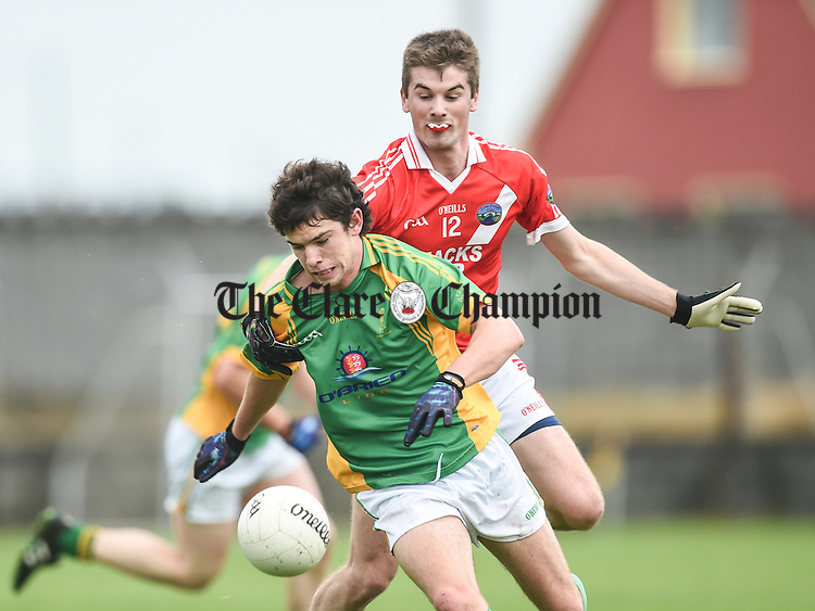 Cian O Dea of Kilfenora in action against Stephen Heapey of Corofin during their intermediate semi-final in Miltown. Photograph by John Kelly.