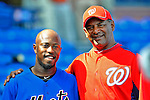 28 February 2011: New York Mets utilityman Willie Harris poses with Jose Martinez from his former team prior to a Spring Training game against the Washington Nationals at Digital Domain Park in Port St. Lucie, Florida. The Nationals defeated the Mets 9-3 in Grapefruit League action. Mandatory Credit: Ed Wolfstein Photo