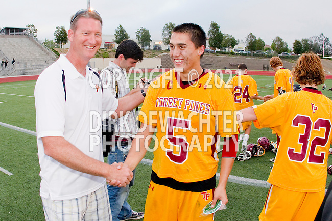 San Diego, CA 05/21/11 - A school official and John Wilson (Torrey Pines #5) and the Torrey Pines Falcons celebrate their 10-7 victory over the Poway Titans for the 2011 CIF San Diego Section Boys Division 1 Lacrosse Championship.