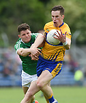 Eoin Cleary of Clare in action against Iain Corbett of Limerick during their Munster championship quarter-final game in Cusack park. Photograph by John Kelly.