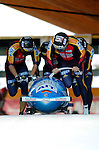 20 November 2005: Andre Lange leads the Germany 1 sled pushoff in the first run of the 2005 FIBT AIT World Cup Men's 4-Man Bobsleigh Tour, piloting the team to a 2nd place, silver medal finish at the Verizon Sports Complex, in Lake Placid, NY. Mandatory Photo Credit: Ed Wolfstein.