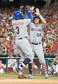 New York Mets center fielder Curtis Granderson (3) is congratulated by first baseman T.J. Rivera (54) after they both scored to tie the game on Grandson's home run in the top of the ninth inning against the Washington Nationals at Nationals Park in Washington, D.C. on Monday, July 3, 2017.  The Nationals won the game 3 - 2.<br /> Credit: Ron Sachs / CNP<br /> (RESTRICTION: NO New York or New Jersey Newspapers or newspapers within a 75 mile radius of New York City)