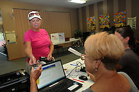 NWA Democrat-Gazette/FLIP PUTTHOFF <br /> Mary Bryant, the 100th voter to cast a ballot in Rogers on Tuesday Sept. 15 2015, checks in with poll workers at Rogers Christian Church, 2421 W. Oak St.