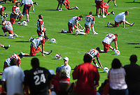 Jul 31, 2009; Flagstaff, AZ, USA; Fans look on as Arizona Cardinals players stretch during training camp on the campus of Northern Arizona University. Mandatory Credit: Mark J. Rebilas-