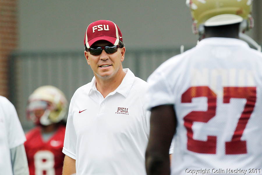 TALLAHASSEE, Fla. 8/8/11-FSU080811 CH-Florida State's Head Coach Jimbo Fisher talks with players during the first day of practice Monday in Tallahassee. .COLIN HACKLEY PHOTO