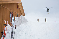 Soldiers receive firewood dropped off by helicopter. The newly built Vouma cabin in Dividalen National Park is part of the Norwegian Trekking Association network. As a goodwill gesture and part of their Arctic training the Royal Navy use helicopters to fly firewood to the remote location. <br /> <br /> <br /> In 2019 the Arctic exercise Clockwork passed 50 years of training in Norway, and now has a permanent base within the Norwegian Air Force base at Bardufoss. <br /> <br /> 845 Naval Air Squadron is a squadron of the Royal Navy's Fleet Air Arm. Part of the Commando Helicopter Force, it is a specialist amphibious unit operating the Leonardo Commando Merlin Mk3 helicopter and provides troop transport and load lifting support to 3 Commando Brigade Royal Marines.<br /> <br /> &copy;Fredrik Naumann/Felix Features