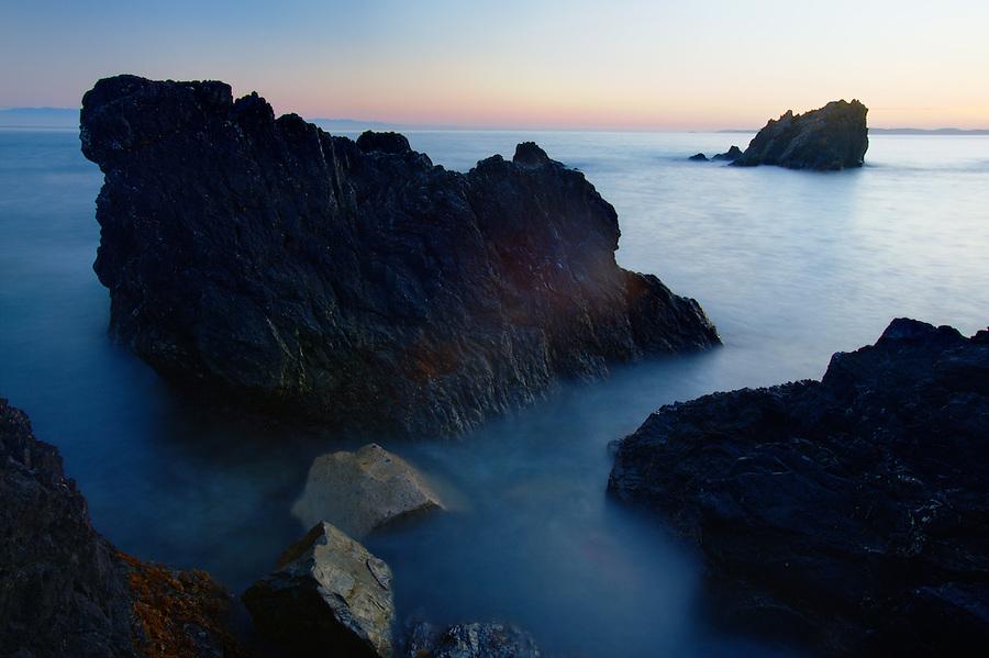 Urchin Rocks with Vancouver Island in distance, Deception Pass State Park, Fidalgo Island, Washington, USA