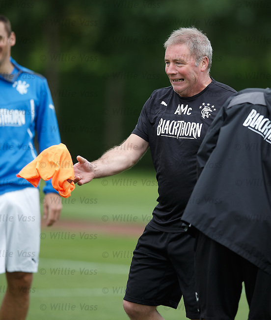 Ally McCoist throws in his bib and has a laugh