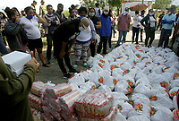 MEDELLIN, COLOMBIA, APRIL 28: People receive food aid that activists, soldiers and police members distributed in a poor neighborhood on April 28, 2020. In Medellín, Colombia. The campaign in Medellín of the ¨Salvar vive ¨ Foundation has benefited the low-income families due to the COVID19 pandemic. (Photo by Fredy Builes/VIEWpress)
