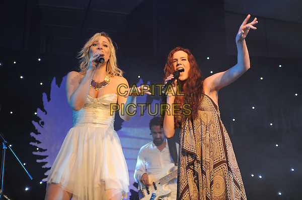 Natasha Bedingfield & Joss Stone.'Global Angels Awards', The Park Plaza Hotel, Westminster, London, England. 2nd December 2011..music on stage live concert gig performing half length microphone singing  brown print scarf paisley dress hand strapless white duet hand .CAP/MAR.© Martin Harris/Capital Pictures.