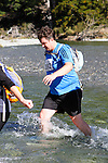 NELSON LAKES, NEW ZEALAND - APRIL 18:  Josh Wilson crosses the Travers River during the 2015 Alpine Lodge Loop The Lake trail run at Lake Rotoiti on April 18 16, 2015 in Nelson, New Zealand. (Photo by Marc Palmano/Shuttersport Limited)