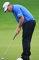 George Coetzee (RSA) putts on the 1st green during Thursday's Round 1 of the 2014 BMW Masters held at Lake Malaren, Shanghai, China 30th October 2014.<br /> Picture: Eoin Clarke www.golffile.ie