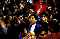 People inside the stock market in Hong Kong.