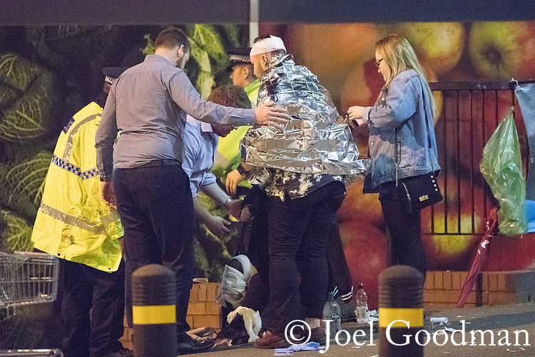 © Joel Goodman - 07973 332324 . 22/05/2017. Manchester, UK. Walking wounded on Corporation Street , opposite Victoria Station . Police and other emergency services are seen near the Manchester Arena after reports of an explosion. Police have confirmed they are responding to an incident during an Ariana Grande concert at the venue. Photo credit : Joel Goodman