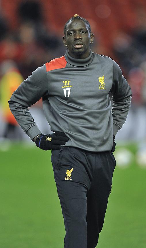 Liverpool's Mamadou Sakho warms up<br /> <br /> Photographer Dave Howarth/CameraSport<br /> <br /> Football - UEFA Champions League Group B - Liverpool v Basel - Tuesday 9th December 2014 - Anfield - Liverpool<br /> <br /> &copy; CameraSport - 43 Linden Ave. Countesthorpe. Leicester. England. LE8 5PG - Tel: +44 (0) 116 277 4147 - admin@camerasport.com - www.camerasport.com